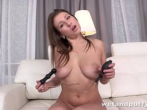 Brunette plays with her pussy until she pees